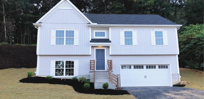 custom home with gray siding