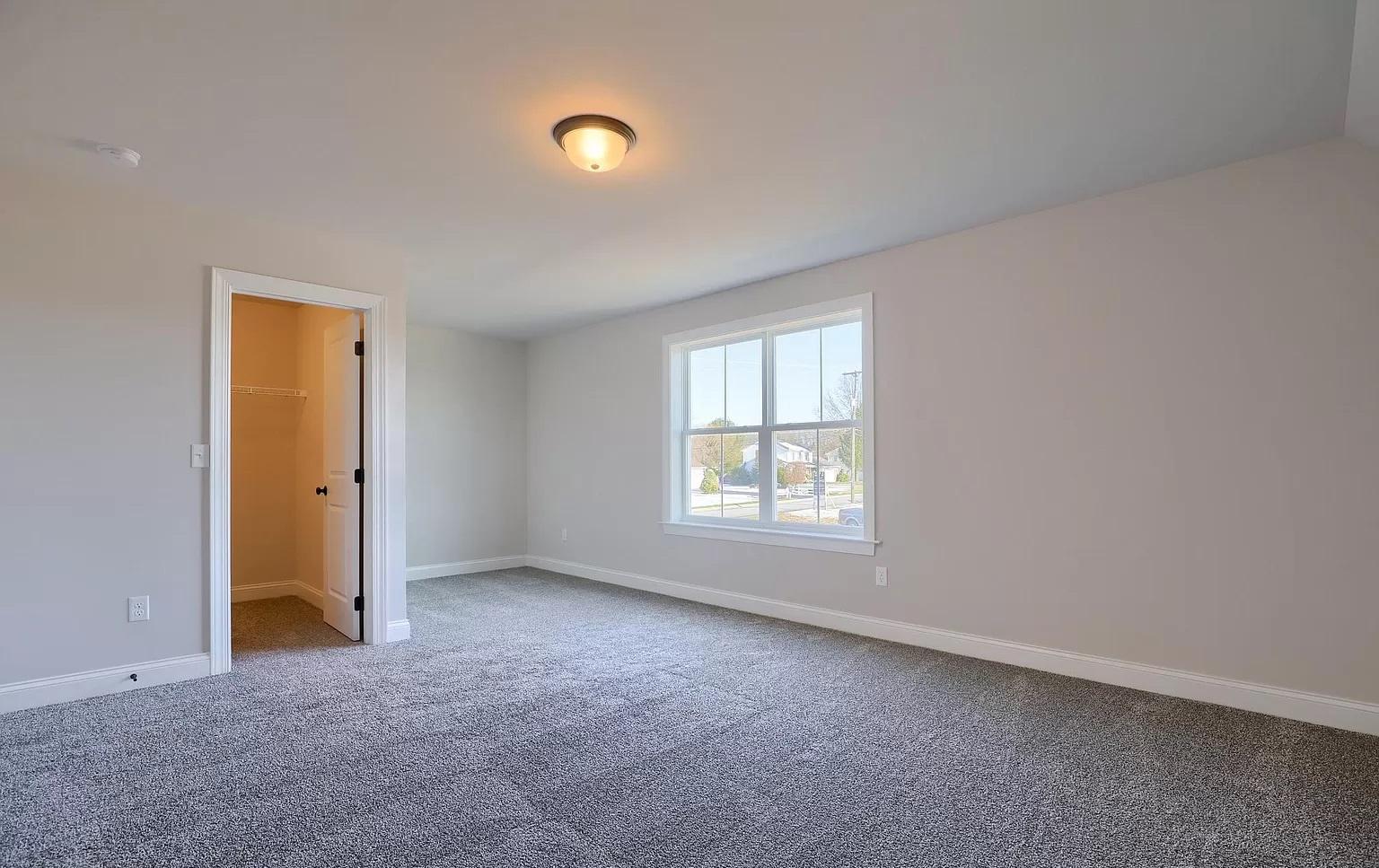 empty bedroom with walk-in closet