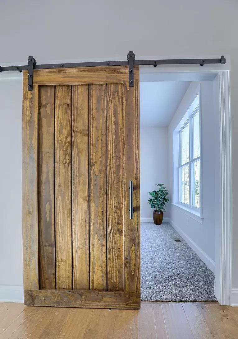 reclaimed barn door in foyer