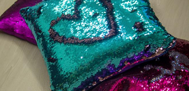 teal and purple sequin pillows