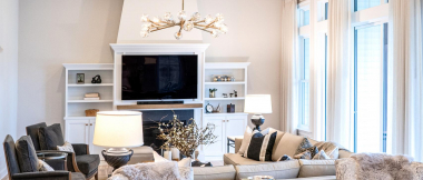 living room with built-in entertainment center and fireplace