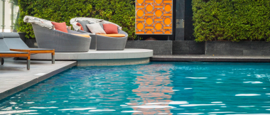 swimming pool with deck and furniture